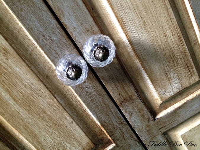 Dressed up the wardrobe with glass knobs that I found at Hobby Lobby.  They have a fabulous selection of accessories for projects like these!