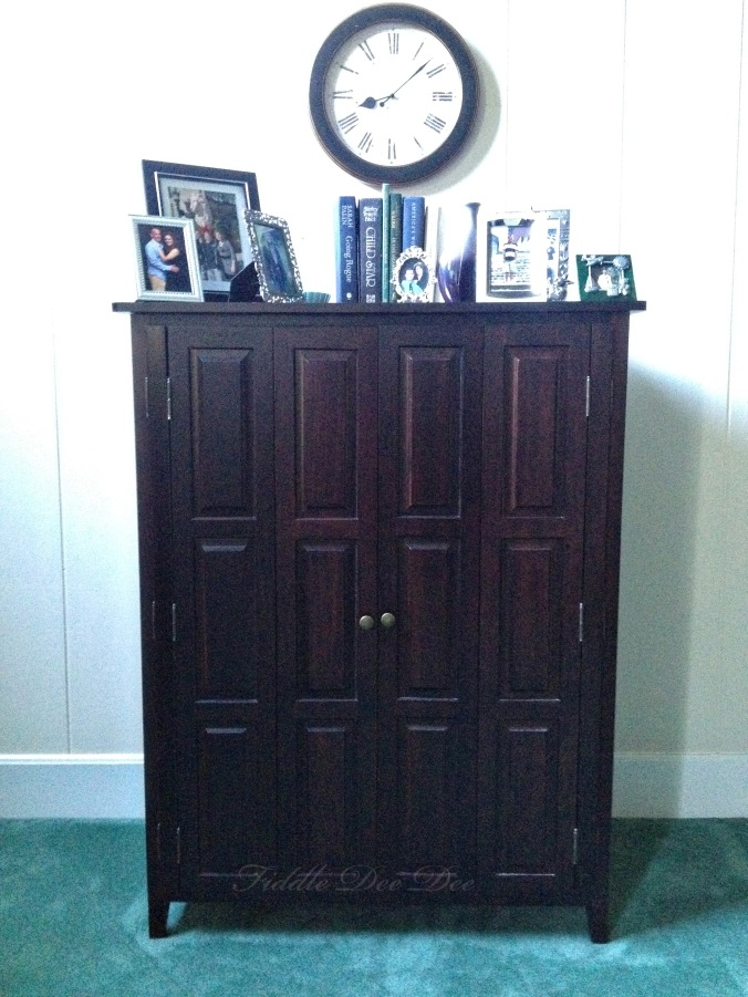 The dark entertainment cabinet that commands much attention in our living room