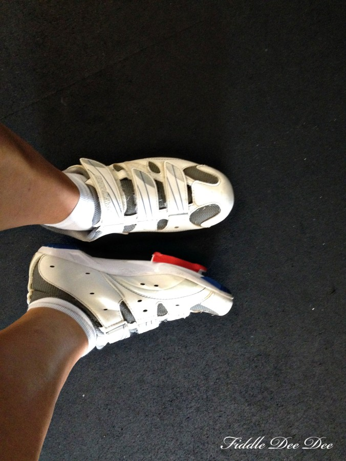 Shoes for spinning are absolutely necessary as they latch onto the bike pedal and keep your foot from slipping off as you are spinning 100 mph!