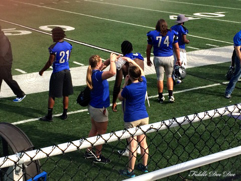 Helping treat an injured football player at the Faulkner game