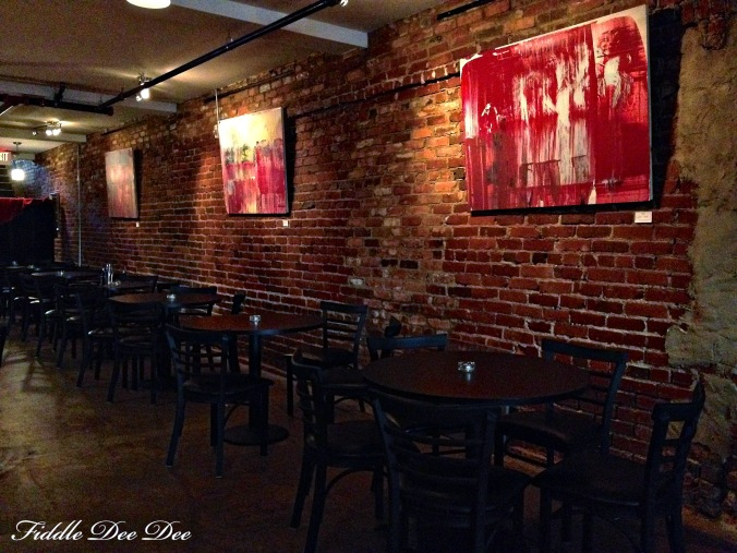 Exposed brick walls with art from a local artist