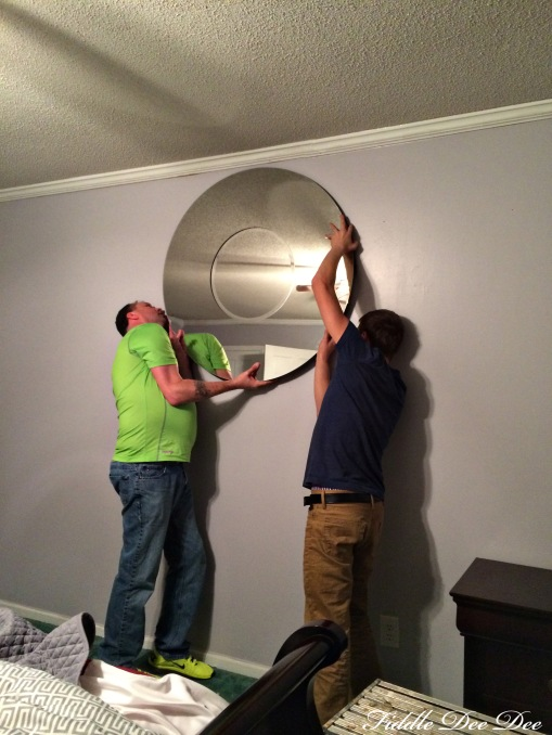 Audley and Bradley hanging the 75 pound mirror that I also found at Costco.